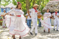 Dancers and musicians perform cuban folk dance. Dancers in costumes and musicians perform traditional cuban folk dance. Cuba, spring 2018 royalty free stock image