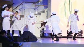 Dancers perform on illuminated stage on festival stock video footage