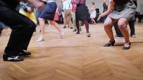 Dancers perform lindy hop dance at the swing festival. Dancing legs close up.