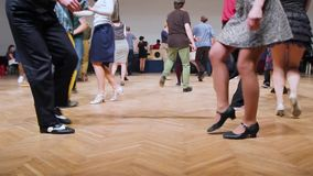 Dancers perform lindy hop dance at the swing festival. Dancing legs close up. Couple dancing to the jazz music on the retro festival. Lindy hop dancers. Swing stock footage