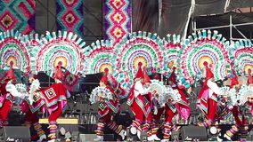 Dancers perform the Quetzales Dance. Mexico City, Mex. 01/12/2018. Dancers perform the Quetzales Dance wearing flashy and colorful traditional suits, as part of stock footage