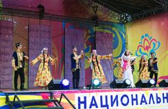 Dancers perform on stage. Stock Images