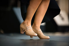Dancers performing Argentinian tango. Legs close-up Royalty Free Stock Image