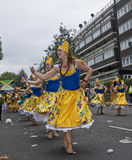 Dancers performing in a street parade Royalty Free Stock Photo