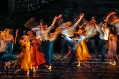 Long exposed and colorful photo of the ballerinas and ballets performing their art in a musical. Royalty Free Stock Photos