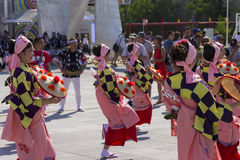 Dancers in pink dresses on the Japanese traditional parade on EXPO 2015 Royalty Free Stock Photo