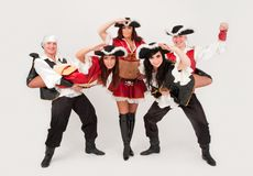 Dancers in pirate costumes dancing Stock Photos
