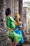 Dancers preparing to the khmer Apsara Dance show, Cambodia. Siem Reap, Cambodia - 28 June 2014: Two women dancers in traditional clothes preparing to the khmer Stock Image