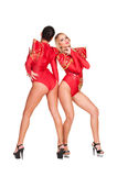 Dancers in red costumes Stock Image