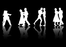 Dancers with Reflections. Four couples dancing silhouetted in white on a black background with a reflective floor Royalty Free Stock Images