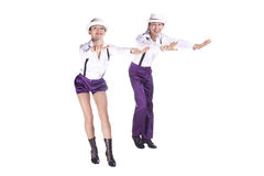 Dancers rock and roll. Studio photography on a white background, dancers dressed as rock and roll Royalty Free Stock Photo