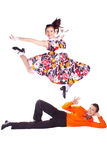 Dancers rock and roll. Studio photography on a white background, dancers dressed as rock and roll Stock Images
