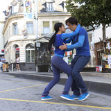 Dancers in the street. AURILLAC, FRANCE- AUGUST 19: Aurillac International Street Theater Festival,Cie P2BYM, a couple is dancing in the street, on August 19 stock image