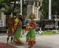 Dancers in Traditional Balinesian Costumes. Port Benoa, Bali, Indonesia--Feb 28, 2016 Dancers in traditional Balinesian costumes greeting tourists at Port Benoa Royalty Free Stock Images