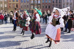 Dancers in traditional Lowicz costume. Polish folk costume. Young people in traditional Lowicz costume are dancing on Warsaw Old Town Square. Polish folk Stock Photography