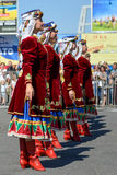 Dancers in ukrainian national costumes. In Dnepropetrovsk, 23 August, celebrate Flag Day. All residents are located on street with yellow-blue flag of Ukraine Stock Photos