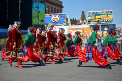 Dancers in ukrainian national costumes. In Dnepropetrovsk, 23 August, celebrate Flag Day. All residents are located on street with yellow-blue flag of Ukraine Royalty Free Stock Photo