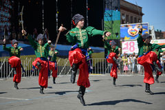 Dancers in ukrainian national costumes. In Dnepropetrovsk, 23 August, celebrate Flag Day. All residents are located on street with yellow-blue flag of Ukraine Royalty Free Stock Photography