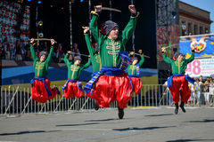 Dancers in ukrainian national costumes. In Dnepropetrovsk, 23 August, celebrate Flag Day. All residents are located on street with yellow-blue flag of Ukraine Royalty Free Stock Photos