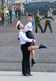 Dancers on Victory Day. ULAN-UDE, RUSSIA - MAY 9: A group of dancers wearing naval uniform perform at the Memorial to the Fallen during WWII on annual Victory stock images