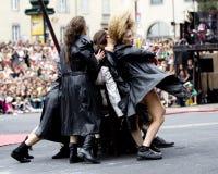 Dancers wearing black raincoats. Stock Photos