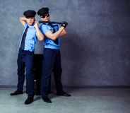 Dancers wearing costumes of policemen Stock Images