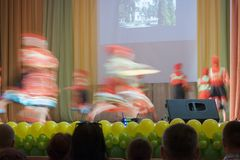 The dancers whirling in fast folk dance on stage concert hall Stock Photography