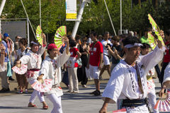 Dancers in white dresses on the Japanese traditional parade on EXPO 2015 Stock Images