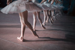 Dancers in white tutu synchronized dancing. On stage. Repetition Stock Photo