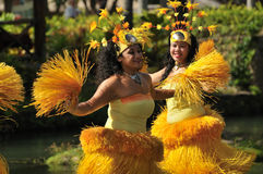 Dancers with Yellow Straw Skirt Stock Images