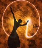 Dances with fire. Silhouette of the girl on a background of the fiery sky Stock Images