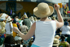 Dancin'. Dancing woman at a jazz festival seen from the back with crowd and stage in the background Stock Photo