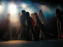 Dancing. A group of dancing girls in a theatre. Look for the color of the light Royalty Free Stock Images