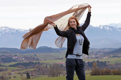 Dancing. Young woman dances with a cloth in autumn before the mountains Royalty Free Stock Image