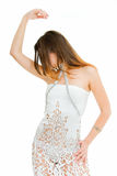 Dancing. Young adult beauty girl in dancing pose on white Royalty Free Stock Image