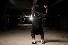 Dancing african american guy in black clothes Stock Image