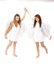 Dancing Angels. Two angels dancing with their arms held high Royalty Free Stock Photo
