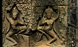 The dancing Apsara on the wall of Bayon Wat Stock Photos