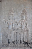 Dancing Apsaras an old Khmer art carvings on the wall in Angkor Royalty Free Stock Image