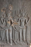 Dancing Apsaras on the wall in Angkor Wat temple Stock Photo