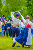 Dancing around the maypole in Midsummer Stock Photo