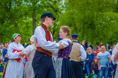Dancing around the maypole in Midsummer Royalty Free Stock Image