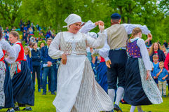Dancing around the maypole in Midsummer Stock Images