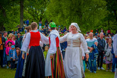 Dancing around the maypole in Midsummer Stock Photos