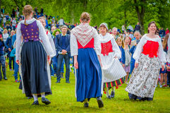 Dancing around the maypole in Midsummer Stock Image