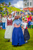 Dancing around the maypole in Midsummer Royalty Free Stock Photography