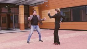 Dancing attractive young men and beautiful young women. businessmen celebrate success and victory. SLOW MOTION. Two businessmen are having fun and laughing stock footage