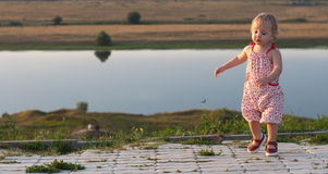 Dancing baby-girl outdoor Stock Photo