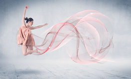 Dancing ballet performance artist with abstract swirl Stock Photography
