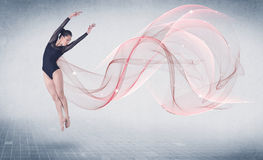 Dancing ballet performance artist with abstract swirl royalty free stock image